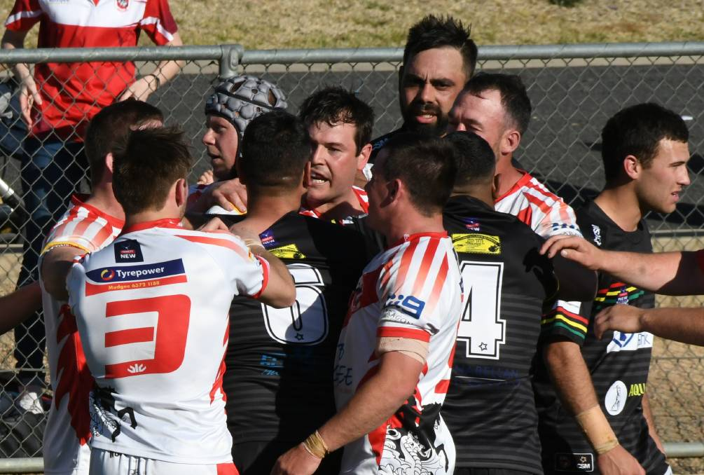 BRING IT ON: Bathurst Panthers and Mudgee Dragons exchange some heat in the 2019 Group 10 grand final. Photo: CHRIS SEABROOK