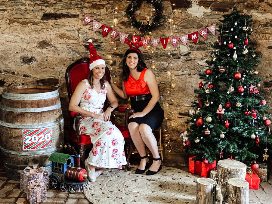 CHRISTMAS CHEER: Marianna Kruger and Jessica Dyer have created the utlimate rustic COVID-Safe Santa photo opportunity for local families. Photo: Jay-Anna Mobbs