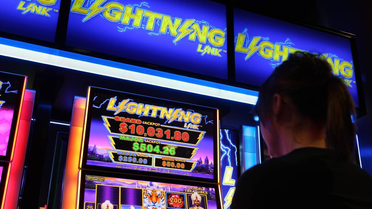 PLAYING TO WIN: Gambling reformers say the pokies are more than a 'dumb box with lights'. Photo: FILE