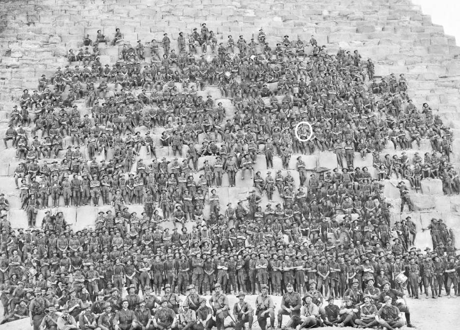 Group portrait of all the original officers and men of the 11th Battalion, 3rd Brigade, AIF, on the side of the Great Pyramid of Khufu (Cheops) near Mena camp.  The Australian War Memorial had identified the soldier circled as Sergeant John (Jack) Wright, formerly of Buckaroo, near Mudgee (circled).  A large version of this photograph is on display at Club Mudgee.  Courtesy of the Australian War Memorial Accession No: P05717.001
