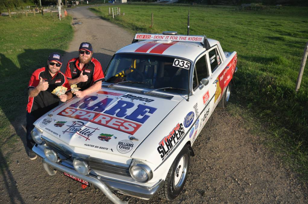 READY FOR THE DRIVE: Brett Abraham and Nekon Greer will take part in the Variety bash in Car 035. Photo: CONTRIBUTED