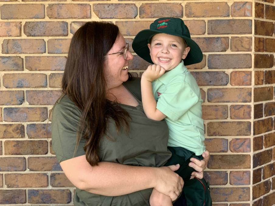 Cassie Jones with her son Charlie at their home in Mudgee. Cassie is one of many Mudgee parents taking to social media to save money in the back to school season. Photo: Benjamin Palmer