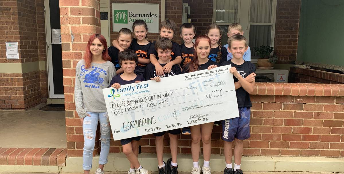 Proudly donning Gerzurgans shirts, the kids presented Barnardos Mudgee with a cheque for $1000.